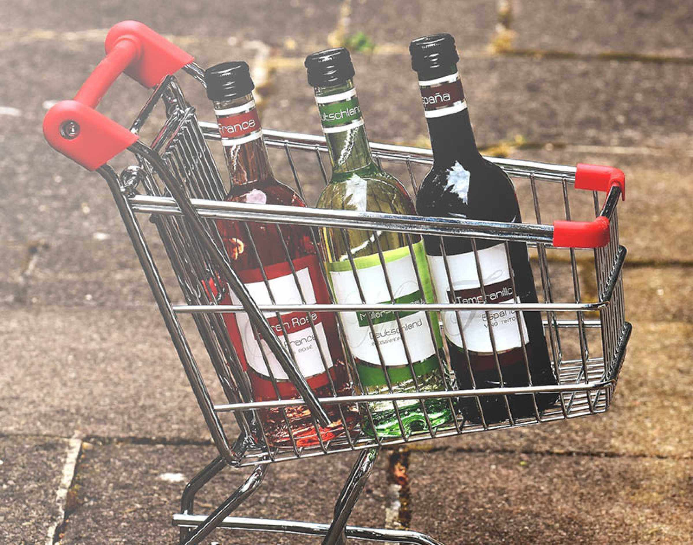 Shopping trolley filled with bottles of wine