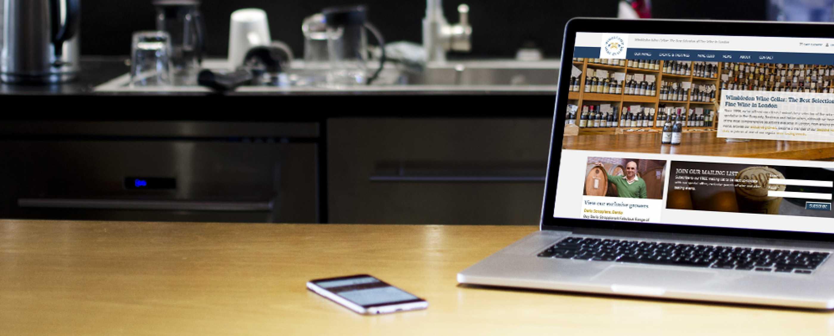 Wimbledon Wine Cellar wine website design on laptop and iphone